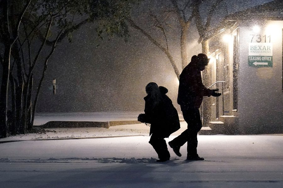Mandatory Credit: Photo by Eric Gay/AP/Shutterstock (11759906b) Two people play in the snow in San Antonio, . Snow and ice blanketed large swaths of the U.S. on Sunday, prompting canceled flights, making driving perilous and reaching into areas as far south as Texas' Gulf Coast, where snow and sleet were expected overnight Winter Weather Texas, San Antonio, United States - 14 Feb 2021